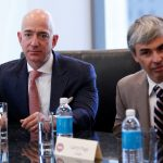 Amazon CEO Jeff Bezos and Larry Page, CEO and Co-founder of Alphabet, sit during a meeting with U.S. President-elect Donald Trump and technology leaders at Trump Tower in New York